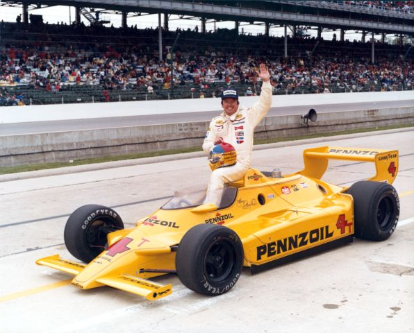 """Johnny Rutherford celebrating his victory at the """"Brickyard""""."""