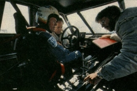 Bobby Unser sitting in the car.