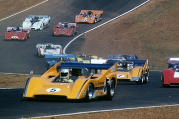 "Denny Hulme and Peter Revson pursuing the ""Bruce and Denny Show"" at Road Atlanta , 1971."