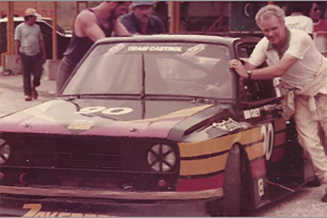 1981, Ian grey pushing his ride around the paddock.