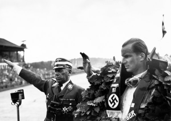 Richard Seaman pictured at the 1938 German Grand Prix giving the Nazi salute.