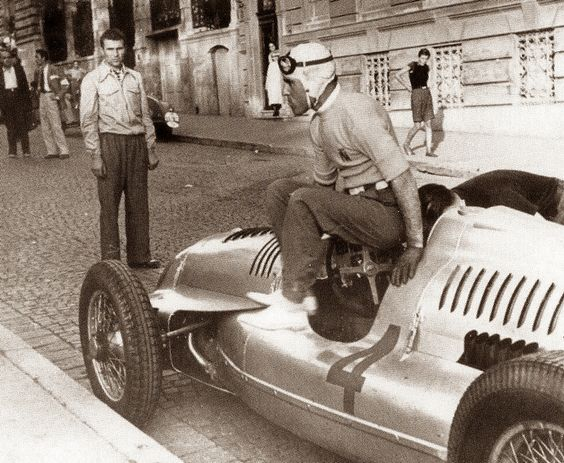 Tazio Nuvolari walking out of his Auto Union. #WinnerChickenDinner